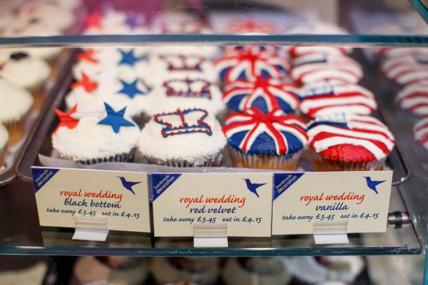 A picture shows cupcakes themed with icing depicting the Union Flag, the US flag, stars and crowns to mark the upcoming Royal Wedding of Prince Harry and US actress Meghan Markle at the Hummingbird Bakery in central London on May 11, 2018. (Photo by Tolga AKMEN / AFP) (Photo credit should read TOLGA AKMEN/AFP/Getty Images)