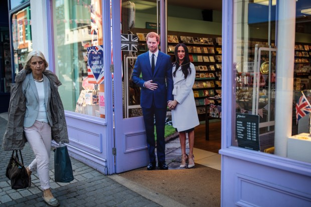 WINDSOR, ENGLAND - MAY 10: A cardboard cut-out display of Prince Harry and his fiance US actress Meghan Markle sits outside a card shop ahead of the couple's wedding on May 10, 2018 in Windsor, England. St George's Chapel at Windsor Castle will host the wedding of Britain's Prince Harry and US actress Meghan Markle on May 19. The town, which gives its name to the Royal Family, is ready for the event and the expected tens of thousands of royalists. (Photo by Jack Taylor/Getty Images)