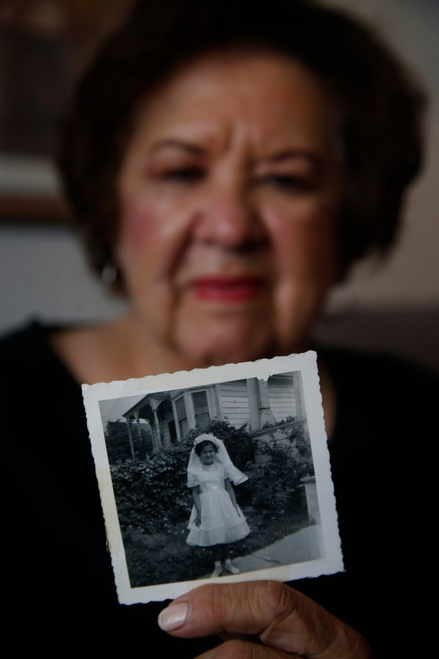 Frances Valdez, 72, had her First Holy Communion back in the mid-50's at Holy Cross Church in San Jose, Calif. She reminisced Tuesday, May 25, 2018, about the old church destroyed by fire four years ago and reopening later this week after a rebuild. (Karl Mondon/Bay Area News Group)