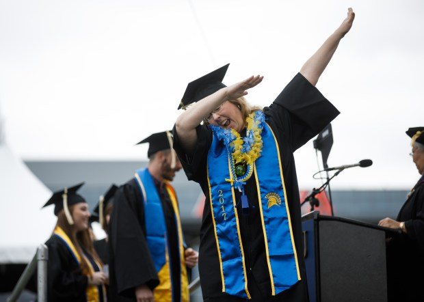San Jose State University graduate Sandie Hesler does the dab during a graduation ceremony on May 24, 2018, at Avaya Stadium in San Jose. (Dai Sugano/Bay Area News Group)
