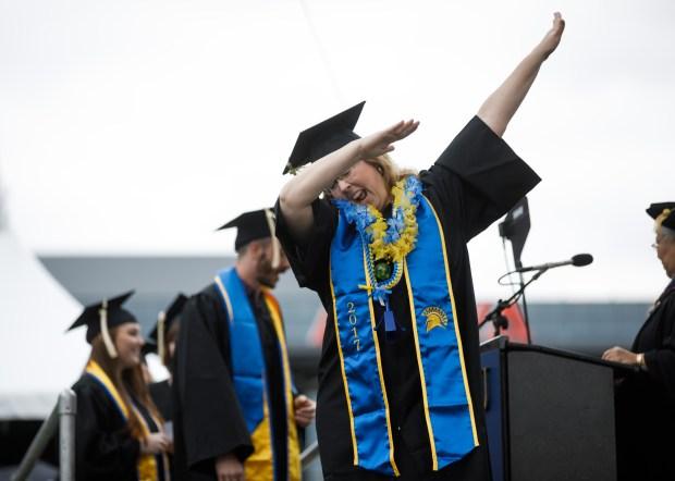 San Jose State University graduate Sandie Hesler does the dab during a graduation ceremony on May 24, 2018, at Avaya Stadium in San Jose. (Dai Sugano/Bay Area News Group)