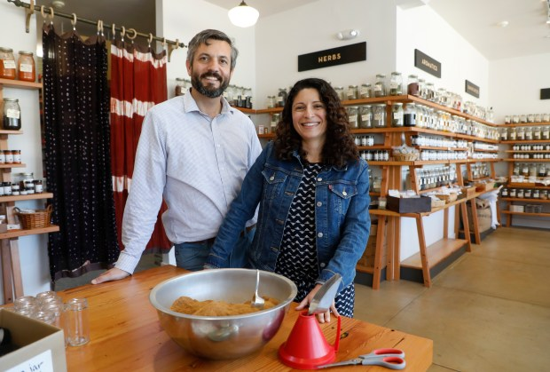 John Beaver and Erica Perez are the owners of Oaktown Spice Shop photographed at their newest location in Albany, Calif., on Tuesday, May 1, 2018. The shop sells a variety of esoteric spices, exotic peppers and other essential ingredients for cooking Thai, Korean, Jamaican, Mexican and Indian fare. (Laura A. Oda/Bay Area News Group)