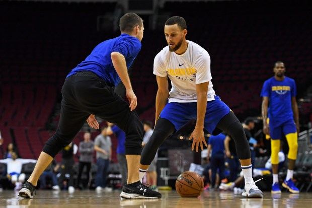 Golden State Warriors' Stephen Curry (30) shoots during a practice session before the NBA Western Conference finals at the Toyota Center in Houston, Texas, on Sunday, May 13, 2018. (Jose Carlos Fajardo/Bay Area News Group)
