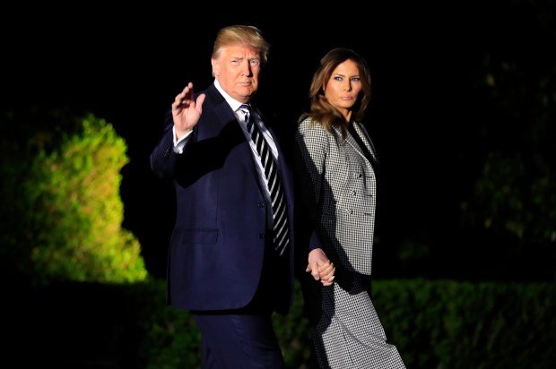 President Donald Trump, with first lady Melania Trump, leaves the White House in Washington, early Thursday, May 10, 2018, to greet three freed Americans detained in North Korea for over a year, who are arriving at Joint Base Andrews, Md. (AP Photo/Manuel Balce Ceneta)