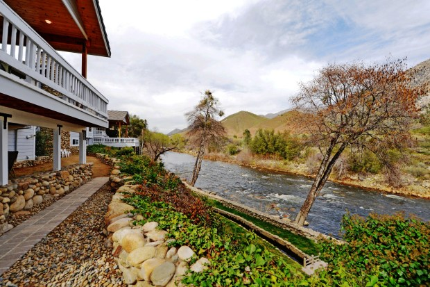 Expansive covered decks overlook the Kern River.