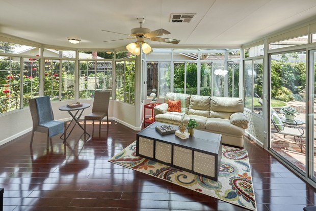 The sunroom adds to the home's entertaining space with peaceful views of the garden.