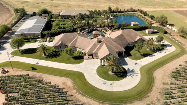 The 7,000-square-foot single-story home features six bedrooms and five bathrooms with a 4.5-acre front yard vineyard.