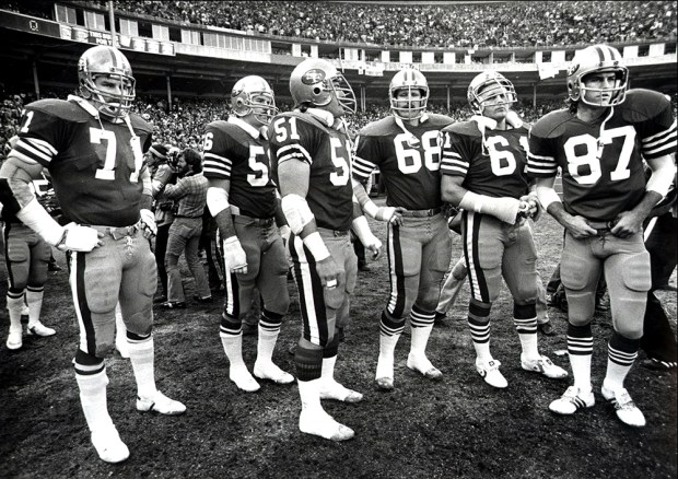 Photo of a the offensive team of the 1981 49ers ready to take the field at Candlestick Park in San Francisco Calif. during the 1981 season where they won their first Superbowl. Pictured from Left to right is #71 Keith Fahnhorst, #56 Fred Quillan, #51 Randy Cross, #68 John Ayers, #61 Dan Audick, and #87 Dwight Clark. (DAN ROSENSTRAUCH/BAY AREA NEWS GROUP)