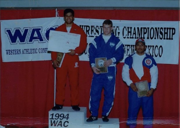 Ricardo Garcia, who has coached the Los Gatos High wrestling team the pastthree seasons, stands atop the medal stand after winning a Western Athletic Conference championship while wrestling for New Mexico in 1994.