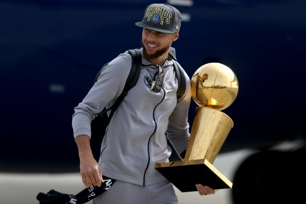 After completing a four-game sweep of the Cleveland Cavaliers to win the 2018 NBA Championship, Golden State Warriors' Stephen Curry walks across the tarmac as the team arrives back in Oakland, Calif., on Saturday, June 9, 2018. (Anda Chu/Bay Area News Group)