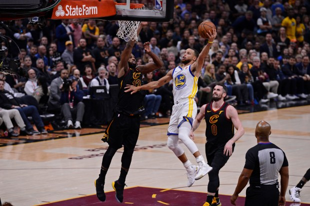 Golden State Warriors' Stephen Curry (30) goes up for a dunk past Cleveland Cavaliers' Tristan Thompson (13) during the first half of Game 3 of the NBA Finals at Quicken Loans Arena in Cleveland, Ohio, on Wednesday, June 6, 2018. The Golden State Warriors defeated the Cleveland Cavaliers110-102. (Jose Carlos Fajardo/Bay Area News Group)