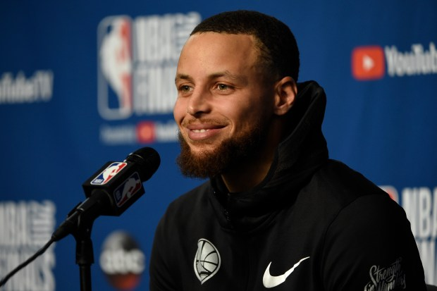 Golden State Warriors' Stephen Curry (30) answers questions from the media before a practice session the day before Game 4 of the NBA Finals at Quicken Loans Arena in Cleveland, Ohio, on Thursday, June 7, 2018. (Jose Carlos Fajardo/Bay Area News Group)