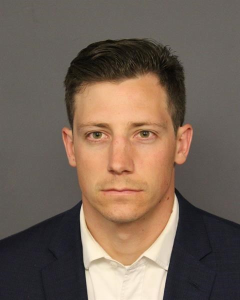 FBI Agent Chase Bishop was booked on suspicion of second-degree assault after his service pistol fell from his pants while he was dancing in a nightclub. The gun went off, injuring a patron, as Bishop picked it up. (Courtesy Denver Police Department)