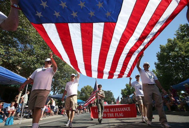 A giant American flag is carried along Hartz Avenue during the annual Fourth of July parade in Danville, Calif., on Saturday, July 4, 2015. The country celebrates its 239th birthday today. (Jane Tyska/Bay Area News Group archive)