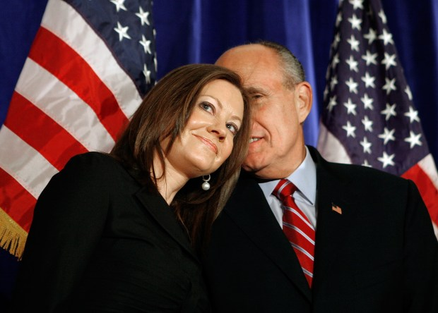 Republican presidential hopeful, former New York City Mayor Rudy Giuliani speaks with his wife Judith Nathan during a news conference at the Mayflower Hotel March 12, 2007 in Washington DC. During the conference Giuliani received endorsements from Sen. David Vitter (R-LA), Bill Simon and Ted Olson. (Photo by Mark Wilson/Getty Images)