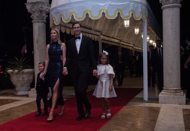 Ivanka Trump, her husband Jared Kushner and their children Arabella and Joseph arrive at a new year's party at US president Donald Trump's Mar-a-Lago resort in Palm Beach, Florida, on December 31, 2017. / AFP PHOTO / NICHOLAS KAMM (Photo credit should read NICHOLAS KAMM/AFP/Getty Images)