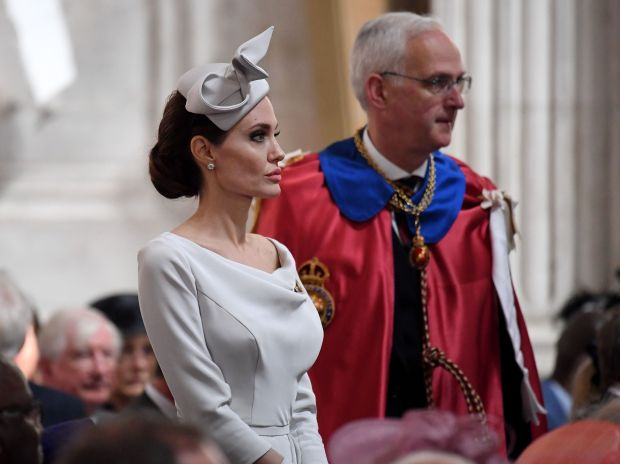 """US actress and Special Envoy for the United Nations High Commissioner for Refugees (UNHCR) Angelina Jolie (L) arrives ahead of the Service of Commemoration and Dedication, marking the 200th anniversary of the Most Distinguished Order of St Michael and St George at St Paul's Cathedral in London on June 28, 2018. - The Order of St Michael and St George is one of the orders of chivalry from which honours are granted by The Queen on the advice of the Prime Minister each year. Britain's Queen Elizabeth II cancelled her engagement to attend the 200th anniversary of the Order of St Michael and St George because she was """"feeling under the weather"""", Buckingham Palace said in a rare change to her schedule. (Photo by Leon NEAL / POOL / Getty Images) (Photo credit should read LEON NEAL/AFP/Getty Images)"""