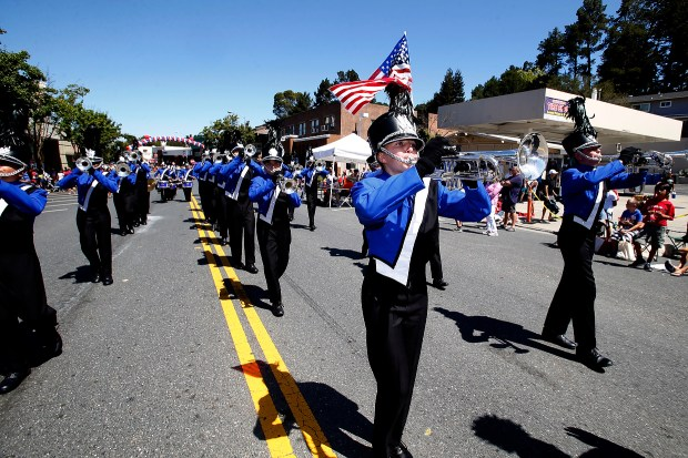 Members of the Blue Devils Corps participate in the Orinda's Fourth of July parade in Orinda, Calif., on Saturday, July 4, 2015.. (Ray Chavez/Bay Area News Group archive)