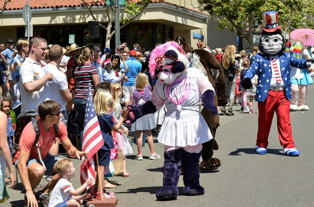Critters by the Bay, shakes hands with parade watchers along Highland Avenue during the City of Piedmont's 4th of July Parade on Monday, July 4, 2016 in Piedmont, Calif. (Photo by Marcus Edwards)