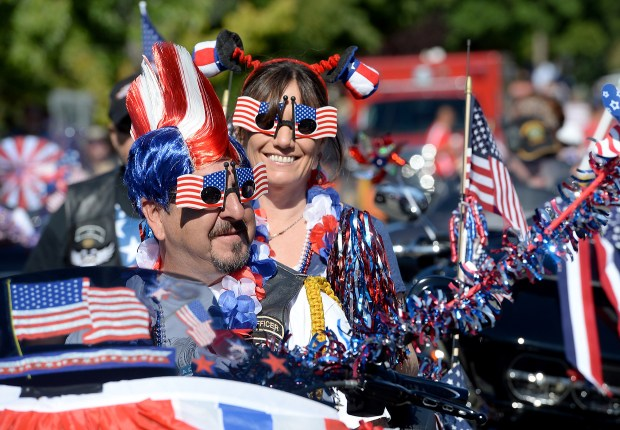 Mark and Rhonda Lovato, of San Ramon, wait for the 4th of July parade to begin as they sit on their motorcycle with other members of the Contra Costa County Harley Owners Group or CCCHOG in Pleasant Hill, Calif., on Monday, July 4, 2016. (Susan Tripp Pollard/Bay Area News Group archive)