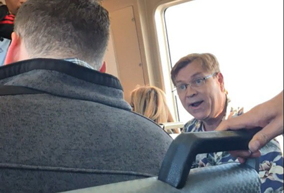 An unidentified man confronts a fellow passenger on BART for eating aburrito on the train.