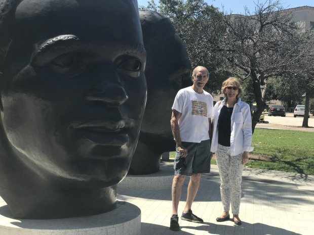 Andre and Inger Dressler, 75 and 76, stand in front of a sculpture of Jackie Robinson at Pasadena City Hall and discuss the ballot initiative to break California into three states. (photo by Julia Prodis Sulek)