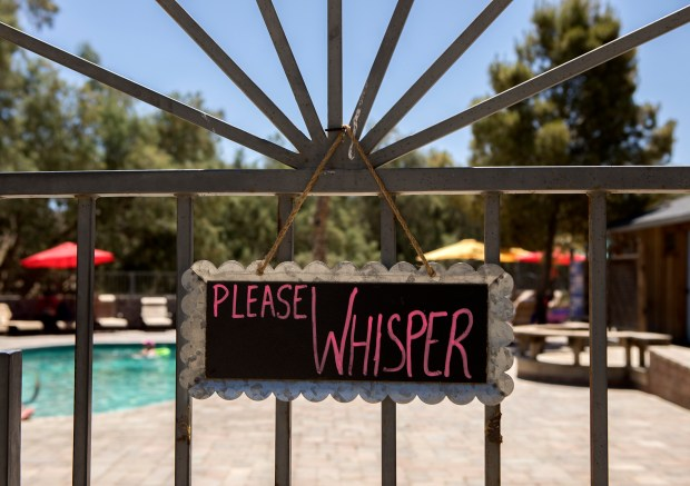 A sign cautions visitors to be quiet on the gate of the pool at Mercey Hot Springs in Firebaugh (Fresno County), California on Thursday, June 14, 2018. The Mercey Hot Springs lies near the border of the proposed three Californias: Northern California (Merced County), California (San Benito County), and Southern California (Fresno County) (LiPo Ching/Bay Area News Group)
