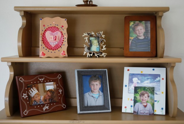 Photos of 14-year-old Marco Mondini cover the shelves at Serena Chietti's home in the outer Richmond area of San Francisco, Calif., on Friday, June 8, 2018. Chietti is the mother of an autistic 14-year-old whom the landlord is using as a reason to evict her from rent-controlled San Francisco apartment saying he is a nuisance. (Laura A. Oda/Bay Area News Group)