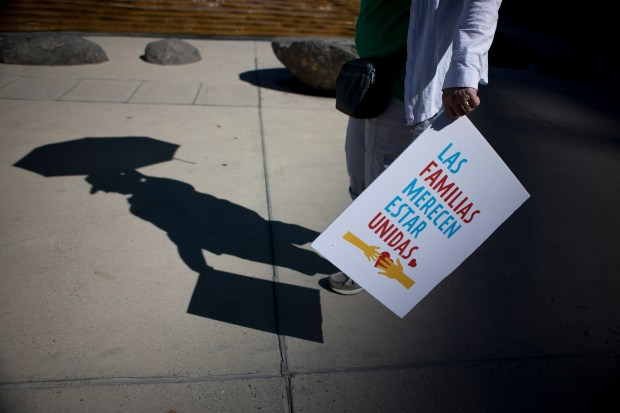 "A shadow of a protester during a ""Families Belong Together"" rally in San Jose, Calif., on Saturday, June 30, 2018. Several rallies were held across the country to protest family separation at the U.S.-Mexico border border under President Trump's ""zero tolerance"" policy. (Randy Vazquez/ Bay Area News Group)"