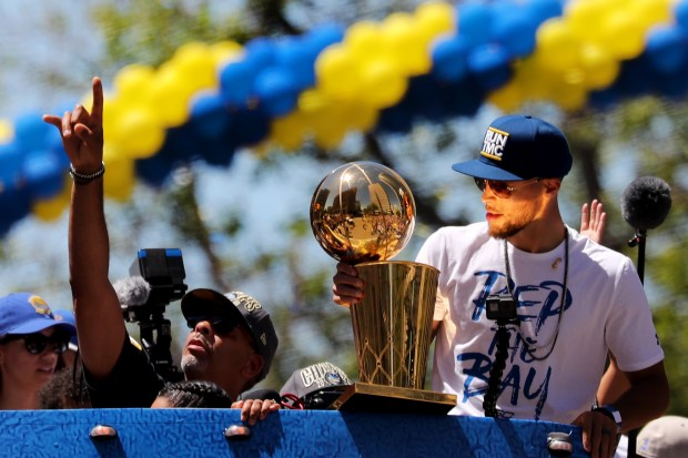 Golden State Warriors  Stephen Curry holds the Larry O Brien NBA  Championship Trophy as 57fe155f1