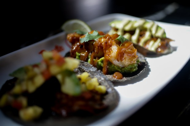 A picture of the trio of tacos made of chicken al pastor, filet mignon and tamarindo shrimp at Puesto in Santa Clara, Calif., on June 6, 2018. This is the first Bay Area location for this Southern Californian al fresco restaurant chain. (Maritza Cruz/ Bay Area News Group)