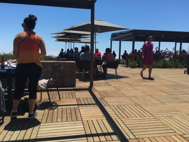 The deck at Ventana Big Sur draws sun-worshippers, hikers and a happy lunchcrowd. (Courtesy Alice Bourget)