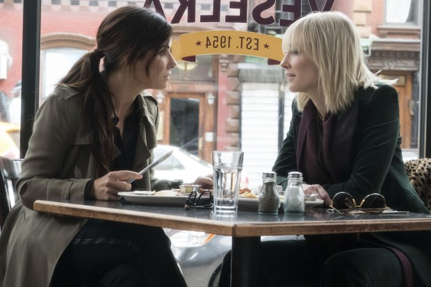 "This image released by Warner Bros. shows Sandra Bullock, left, and Cate Blanchett in a scene from ""Ocean's 8."" (Barry Wetcher/Warner Bros. via AP)"