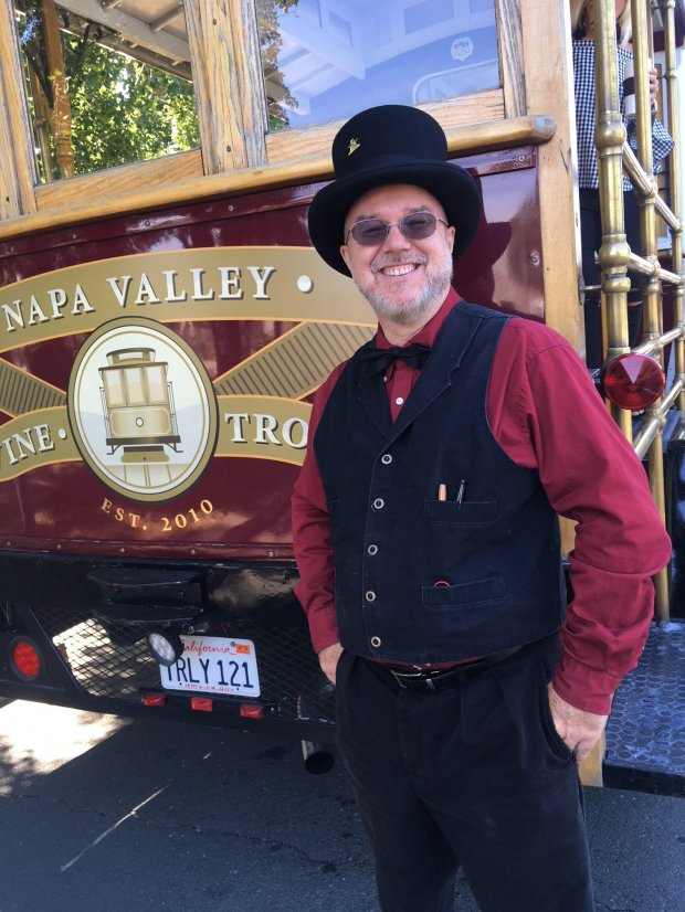 *Napa Valley Wine Trolley driver and tour guide Epaul Fischer welcomesguests aboard for a winery tour. (Courtesy Allen Pierleoni)*