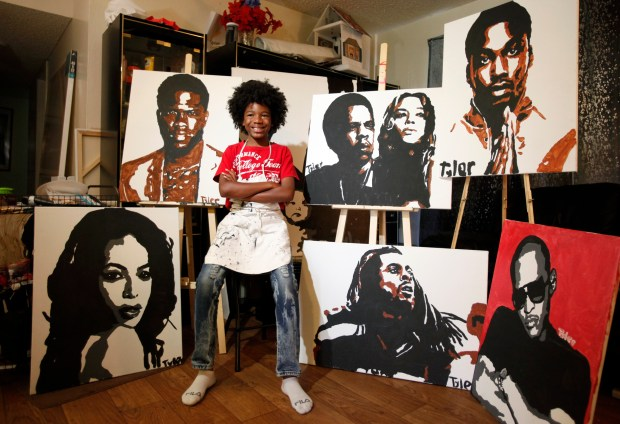 Tyler Gordon, 11, poses with a group of his portraits at his home in San Jose, Calif., Wednesday, June 20, 2018.(Will Butler/Mosaic)