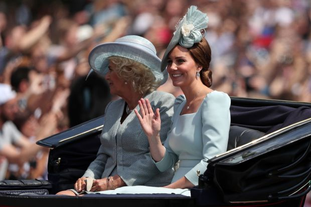 Britain's Camilla, Duchess of Cornwall (L) and Britain's Catherine, Duchess of Cambridge return in a horse-drawn carriage after attending the Queen's Birthday Parade, 'Trooping the Colour' on Horseguards parade in London on June 9, 2018. - The ceremony of Trooping the Colour is believed to have first been performed during the reign of King Charles II. In 1748, it was decided that the parade would be used to mark the official birthday of the Sovereign. More than 600 guardsmen and cavalry make up the parade, a celebration of the Sovereign's official birthday, although the Queen's actual birthday is on 21 April. (Photo by Daniel LEAL-OLIVAS / AFP) (Photo credit should read DANIEL LEAL-OLIVAS/AFP/Getty Images)