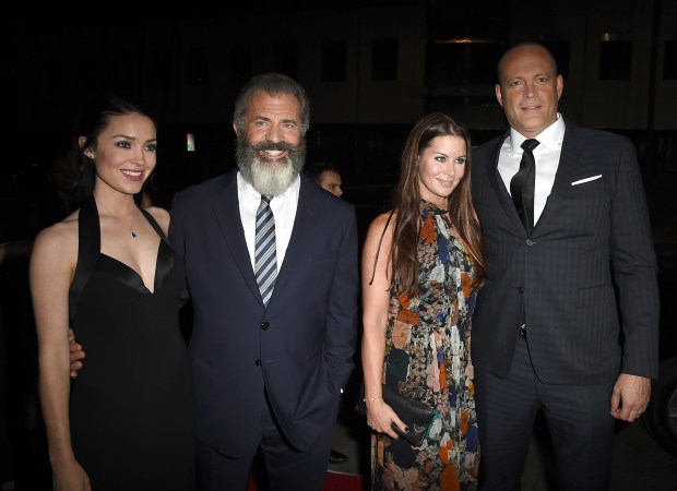 """BEVERLY HILLS, CA - OCTOBER 24: (L-R) Rosalind Ross, director Mel Gibson, Kyla Weber and actor Vince Vaughn attend the screening of Summit Entertainment's """"Hacksaw Ridge"""" at Samuel Goldwyn Theater on October 24, 2016 in Beverly Hills, California. (Photo by Kevin Winter/Getty Images)"""