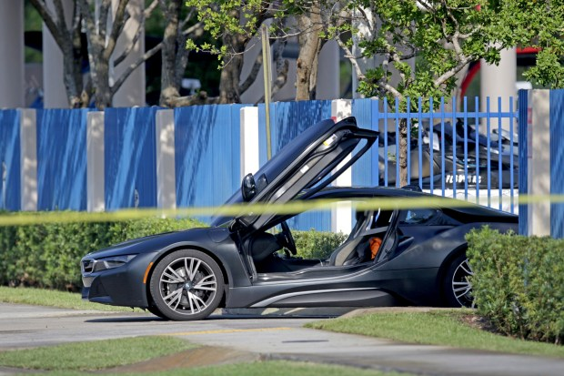An empty vehicle appears on a street where rapper XXXTentacion was shot on Monday, June 18, 2018, in Deerfield Beach, Fla. (John McCall/South Florida Sun-Sentinel via AP)