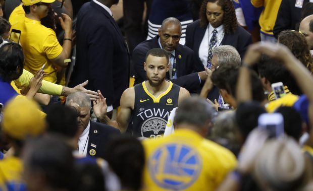 Golden State Warriors' Stephen Curry (30) leaves the court following their 122-103 win over the Cleveland Cavaliers for Game 2 of the NBA Finals at Oracle Arena in Oakland, Calif., on Sunday, June 3, 2018. (Nhat V. Meyer/Bay Area News Group)