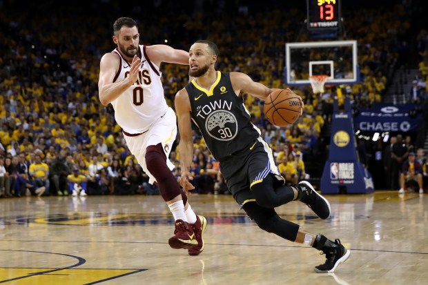 Stephen Curry (30) of the Golden State Warriors drives to the basket defended by Kevin Love #0 of the Cleveland Cavaliers in Game 2 of the 2018 NBA Finals at ORACLE Arena on June 3, 2018 in Oakland, California. (Photo by Ezra Shaw/Getty Images)