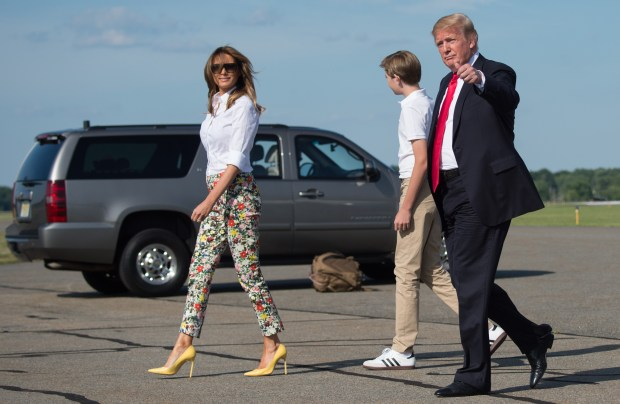 US President Donald Trump, First Lady Melania Trump and son Barron disembark from Air Force One upon arrival at Morristown Municipal Airport in Morristown, New Jersey, June 29, 2018, as they travel for the weekend to Bedminster, New Jersey. (Photo by SAUL LOEB / AFP) (Photo credit should read SAUL LOEB/AFP/Getty Images)