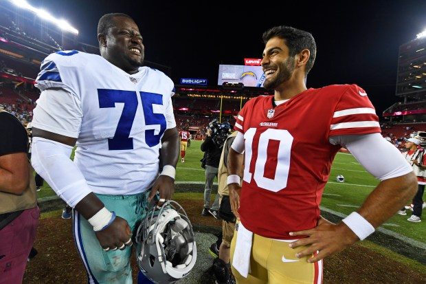 8d5e00f34 Cameron Fleming of the Dallas Cowboys shares a laugh with Jimmy Garoppolo  after their preseason game at Levi s Stadium. (Jose Carlos Fajardo Bay Area  News ...