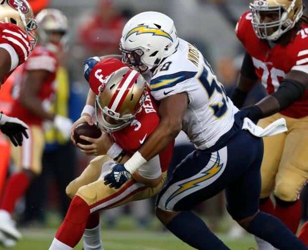 a58b6071f San Francisco 49ers  C.J. Beathard (3) is sacked by Los Angeles Chargers   Uchenna Nwosu (58) in the first quarter at Levi s Stadium in Santa Clara