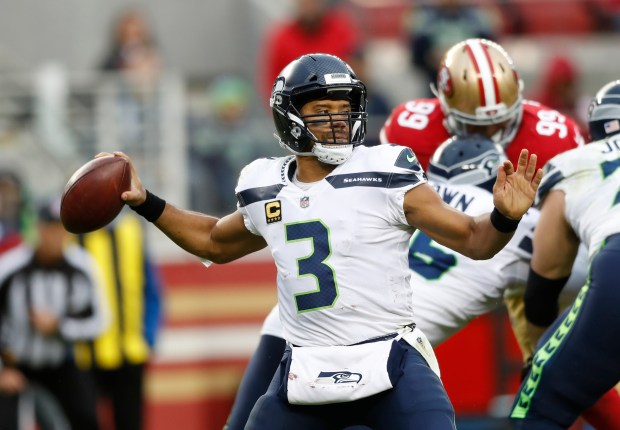 Seattle Seahawks Russell Wilson 3 Throws The Ball Against San Francisco 49ers In First Quarter Of Their NFL Game At Levis Stadium Santa Clara