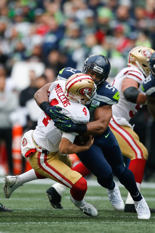 416f4acee Bobby Wagner  54 of the Seattle Seahawks sacks Nick Mullens  4 of the San  Francisco 49ers in the first quarter at CenturyLink Field on December 2