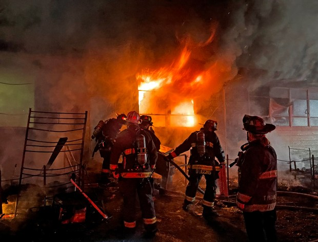 Firefighters battle an early morning fire that burnt through parts of the Vietnamese American Community Center of the East Bay in Oakland, Calif., on Saturday, Feb. 6, 2021. (Courtesy of the Oakland Fire Department)