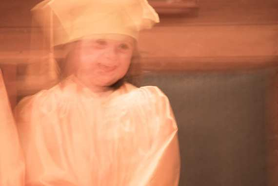 Child with Down syndrome graduates from kindergarten