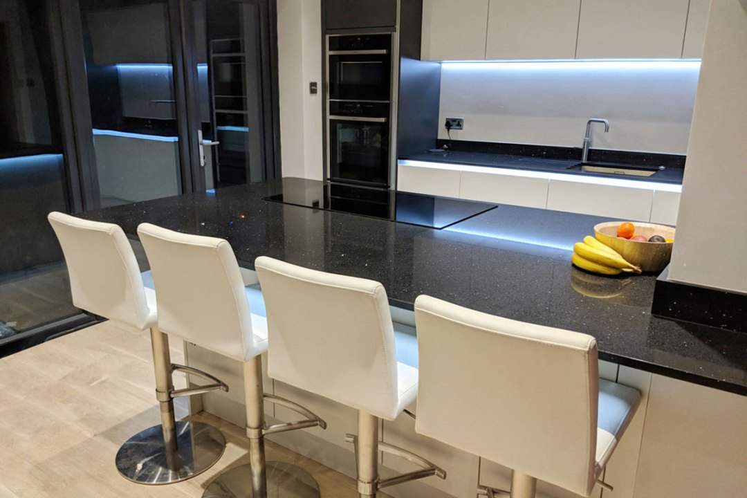Breakfast bar and stools; kitchen design, supply and install by Meridien Interiors