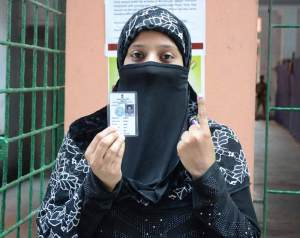 File Photo: An Indian Muslim Women after casting her vote in election.