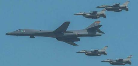 US Military's B-1B Nuclear Capable Supersonic Long Range Bomber escorted by other fighter aircraft.